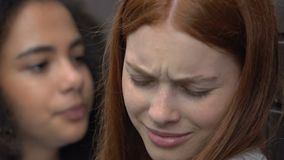 Ginger female suffers intimidations and bullying from biracial girl, threats. Stock footage stock video footage