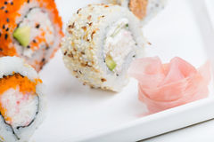 Ginger in focus and shushi on the background Royalty Free Stock Photography