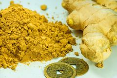 Ginger, fresh root and dried powder. In a closeup Stock Photos