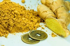 Ginger, fresh root and dried powder. Ina closeup Royalty Free Stock Images