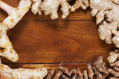 Ginger,galangal and curcuma longa on wood Stock Photography