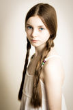 Ginger girl with blue eyes and plaits Stock Photos