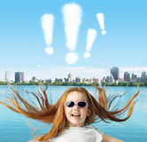 Ginger girl with exclamation marks above Royalty Free Stock Photo