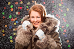 Ginger girl in fur coat wearing mittens with snow Stock Photography