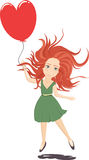 Ginger girl in green dress with heart-shaped balloon. Stock Images