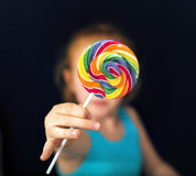 Ginger girl holding a sweet lollipop Royalty Free Stock Images