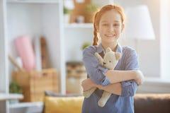 Ginger Girl Hugging Bear imagen de archivo