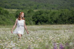 Ginger girl on meadow stock photo