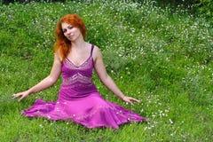 Ginger girl in purple dress Stock Photo
