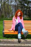 Ginger girl on roller skates Royalty Free Stock Photos