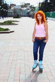 Ginger girl on roller skates Stock Photo