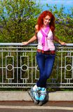 Ginger girl on roller skates Stock Image