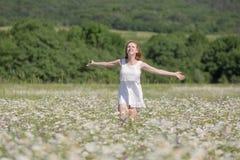Ginger girl runs on meadow Royalty Free Stock Photos