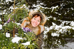 Ginger girl in snowy forest Royalty Free Stock Photography