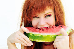 Ginger girl with watermelon Royalty Free Stock Images