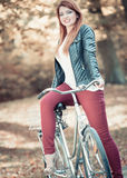 Ginger hair lady on the bike. Royalty Free Stock Photo