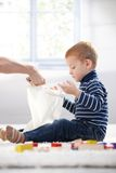 Ginger-haired little boy playing at home Stock Photography
