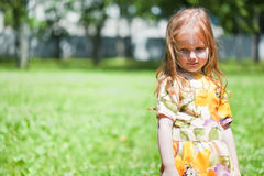 Ginger-haired smiling girl in the field Royalty Free Stock Photo