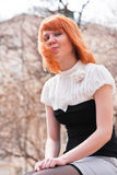 Ginger-haired woman putting out her tongue Royalty Free Stock Images