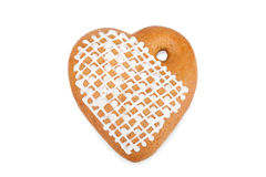 Ginger heart-shaped cookie with beautiful small rose isolated Royalty Free Stock Images