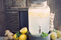 Ginger homemade lemonade in a beverage dispencer Royalty Free Stock Image