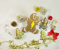 Ginger and honey different shape cookies with a lot of Christmas balls, presents Stock Photo