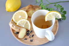 Ginger Hot Tea with Lemon. Sliced and fresh ginger on wooden plate Royalty Free Stock Image