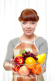 Ginger Housewife Holding Fruits Royalty Free Stock Image