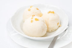 Ginger ice cream with melted milk in a bowl Stock Photography