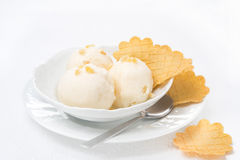 Ginger ice cream with melted milk and thin waffles Royalty Free Stock Photography