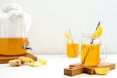 Ginger and lemon combucha detox drink in two jars stock image