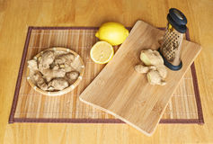 Ginger, lemon and grater Stock Photo