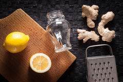 Ginger, lemon, grater and jar Stock Image