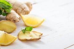 Ginger lemon mint on white wood background. Copy space Stock Image
