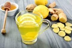 Ginger and lemon tea. Glass with ginger and lemon tea stock photos