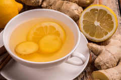 Ginger and lemon tea. In white cup stock photo