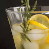 Ginger lemonade and ingredients - ginger, lemon, black backgrou. Nd Royalty Free Stock Photos