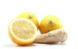 Ginger and lemons. Isolated on white background stock photography