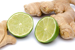 Ginger with a lime cut in half Stock Image