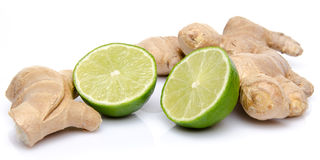 Ginger with a lime cut in half. On white Royalty Free Stock Image