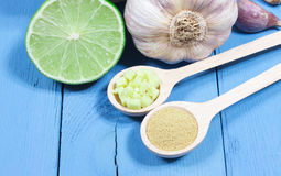 Ginger, lime, and garlic. Concept for natural medicine. Ginger, lime and garlic, fresh and healthy food products, concept for natural medicine royalty free stock images