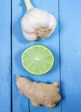 Ginger, lime, and garlic. Concept for natural medicine. Ginger, lime and garlic, fresh and healthy food products, concept for natural medicine stock photography