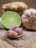 Ginger, lime, and garlic. Concept for natural medicine. Ginger, lime and garlic, fresh and healthy food products, concept for natural medicine stock photos