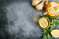 Ginger, mint and tea. Fresh ginger,herb and tea on a table royalty free stock photo