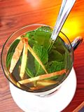 Ginger mint tea. Glass of ginger and mint tea Stock Photo