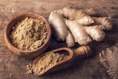 Ginger powder and roots royalty free stock images