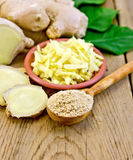 Ginger powder and grated with root and leaves Stock Image