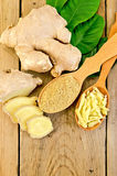 Ginger powder and grated in the spoon with the root Royalty Free Stock Photography
