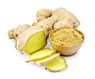 Ginger powder in wooden bowl with root Royalty Free Stock Photos