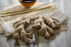 Ginger roorts on glass background Stock Images